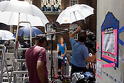 Amercian NBC TV correspondent Natalie Morales plus technicians reports live for the Today show from media village behind railings as tension mounts outside St Mary's Hospital, Paddington London. Here, media and royalists await news of Kate, Duchess of Cambridge's impending labour and birth. Some have been camping out for up to two weeks during a UK heatwave, having bagged the best locations where an heir to the British throne will eventually be shown to the world.