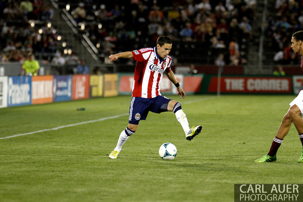 May 25th, 2013 Commerce City, CO - Chivas USA midfielder Eric Avila (15) handles the ball in the second half of the MLS match between Chivas USA and the Colorado Rapids at Dick's Sporting Goods Park in Commerce City, CO