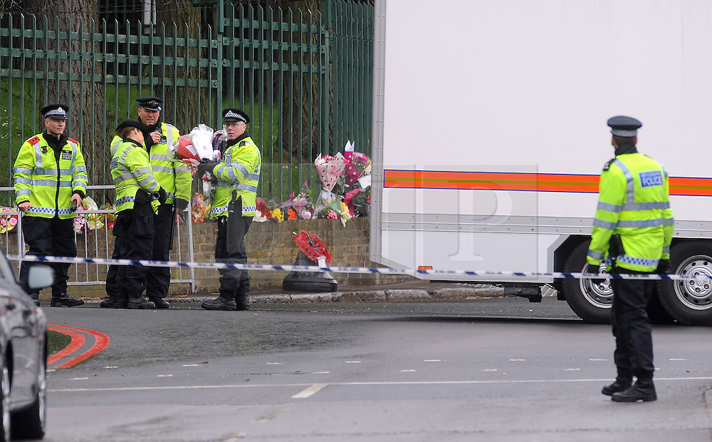 © Licensed to London News Pictures. 23/05/2013.Woolwich Soldier Murder. Police place flowers on Artillery Place at the crime scene..Woolwich 'terrorist attack': One dead and two seriously injured. Woolwich Barracks,Woolwich..Photo credit :Grant Falvey/LNP