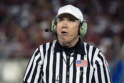 September 19, 2009; Stanford, CA, USA;  NCAA referee David Lambros wears a headset while reviewing a play in the second quarter between the Stanford Cardinal and the San Jose State Spartans at Stanford Stadium. Stanford defeated San Jose State 42-17. Mandatory Credit: Jason O. Watson-US PRESSWIRE