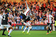 Brentford midfielder Ryan Woods (15)  fouling Nottingham Forest midfielder Pajtim Kasami (22)  during the EFL Sky Bet Championship match between Brentford and Nottingham Forest at Griffin Park, London, England on 16 August 2016. Photo by Matthew Redman.