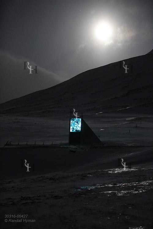 Global Seed Vault glows beneath full moon in January during the long polar night in Longyearbyen on Spitsbergen island, Svalbard, Norway.