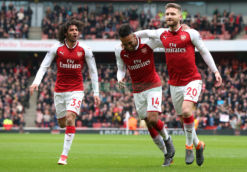 Arsenal's Shkodran Mustafi (right) celebrates scoring his side's first goal of the game during the Premier League match at the Emirates Stadium, London.