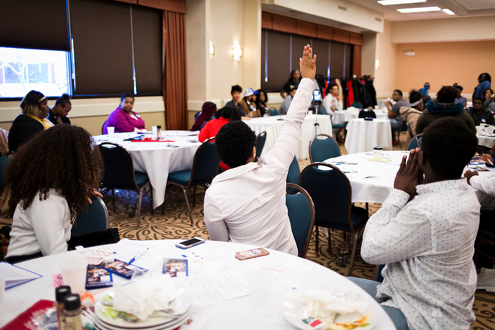 Students pose questions during the Black Excellence Youth Conference at the Best Western Plus Inntowner on Monday, Jan. 15, 2018.