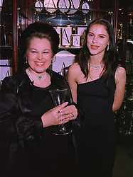 Left to right, MRS SORAYA KHASHOGGI, ex wife of Middle Eastern millionaire Adnan Khashoggi, and her daughter PETRINA KHASHOGGI, at a party in London on 26th November 1997.MDS 61