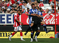 Photo: Lee Earle.<br /> Charlton Athletic v Sheffield Wednesday. Coca Cola Championship. 25/08/2007. Wednesday's Tommy Spurr is congratulated after scoring their second goal. Charlton's Jerome Thomas (L) looks dejected.