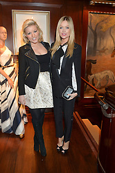 Left to right, NATALIE COYLE and LAURA WHITMORE at a party to celebrate the publication of Front Roe by Louise Roe held at Ralph Lauren, 1 New Bond Street, London on 1st April 2015.