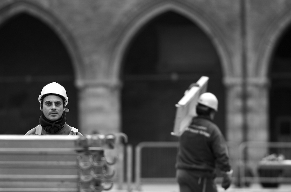 Black and white photography. Worker in downtown Bologna Italy.
