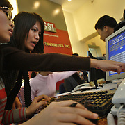 Staff fight to keep pace with traders on the floor at SSI (Saigon Securities Inc.) in Hanoi. SSI is one of the largest  stock brokerage firms in Vietnam, where trading stocks has become so popular the brokerage has to move into a new, much larger floorspace later this year to accomodate the rush to buy and sell on Vietnam's opening market.