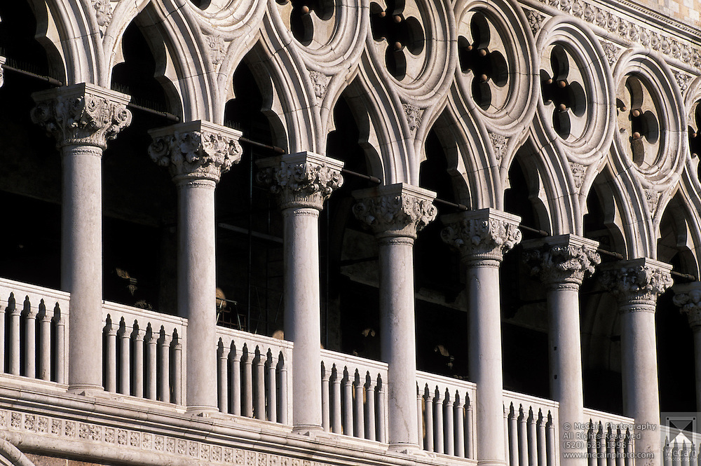 "Ornate gothic arches of The Doge's Palace ""Palazzo Ducale di Venezia"" was the residence of the Doge of Venice. The palace was largely constructed from 1309 to 1424, and today houses a museum, Venice, Italy...Subject photograph(s) are copyright Edward McCain. All rights are reserved except those specifically granted by Edward McCain in writing prior to publication...McCain Photography.211 S 4th Avenue.Tucson, AZ 85701-2103.(520) 623-1998.mobile: (520) 990-0999.fax: (520) 623-1190.http://www.mccainphoto.com.edward@mccainphoto.com."
