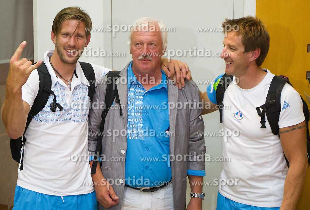 Iztok Cop and Luka Spik with coach Milos Jansa during reception of Slovenian Olympic team, on August 5, 2012 in Airport Joze Pucnik, Brnik, Slovenia. (Photo by Vid Ponikvar / Sportida.com)