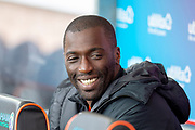 Morgaro Gomis (#13) of Dundee United FC in the dugout before the William Hill Scottish Cup quarter final match between Dundee United and Inverness CT at Tannadice Park, Dundee, Scotland on 3 March 2019.
