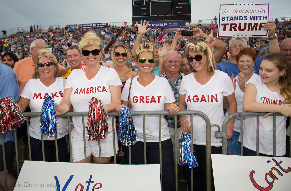 Aug. 21. 2015 Mobile, AL, Trump supporters at his campaign pep rally in Ladd Peebles Stadium. These women are all party of the Republican Party and plan to vote for Trump. <br />