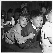Lunch hour at the Raphael Weill Public School, Geary and Buchanan Streets, in the so-called international section. Many children of Japanese ancestry were evacuated with their parents from this neighborhood. Educational facilities will be established at War Relocation Authority centers where evacuees will spend the duration. -- Photographer: Lange, Dorothea -- San Francisco, California. 4/17/42<br /> Identifier:<br /> Volume 56<br /> Identifier:<br /> Section G<br /> Identifier:<br /> WRA no. A-72<br /> Collection:<br /> War Relocation Authority Photographs of Japanese-American Evacuation and Resettlement Series 14: Preevacuation<br /> Contributing Institution:<br /> The Bancroft Library. University of California, Berkeley.