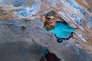 """Writer, editor, and climber Alison Osius climbing """"Fistful of Dollars"""" 11c at Rifle Mountain Park in Colorado."""