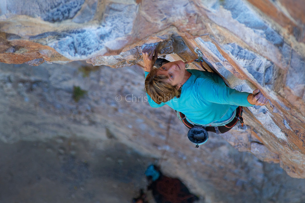 "Writer, editor, and climber Alison Osius climbing ""Fistful of Dollars"" 11c at Rifle Mountain Park in Colorado."