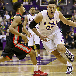 Jan 26, 2016; Baton Rouge, LA, USA; LSU Tigers forward Ben Simmons (25) drives past Georgia Bulldogs guard J.J. Frazier (30) during the first half of a game at the Pete Maravich Assembly Center. Mandatory Credit: Derick E. Hingle-USA TODAY Sports