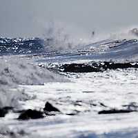 Several days of persistent easterly winds cause big waves to crash along the surf in Asbury Park New Jersey.   Waves to 10 feet with big white water, current and foam pounded the area that was just replenished with sand.