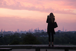 Primrose Hill, London, August 25th 2016. After a hot, sticky night, dawn, viewed from Primrose Hill, breaks across London. ©Paul Davey<br /> FOR LICENCING CONTACT: Paul Davey +44 (0) 7966 016 296 paul@pauldaveycreative.co.uk