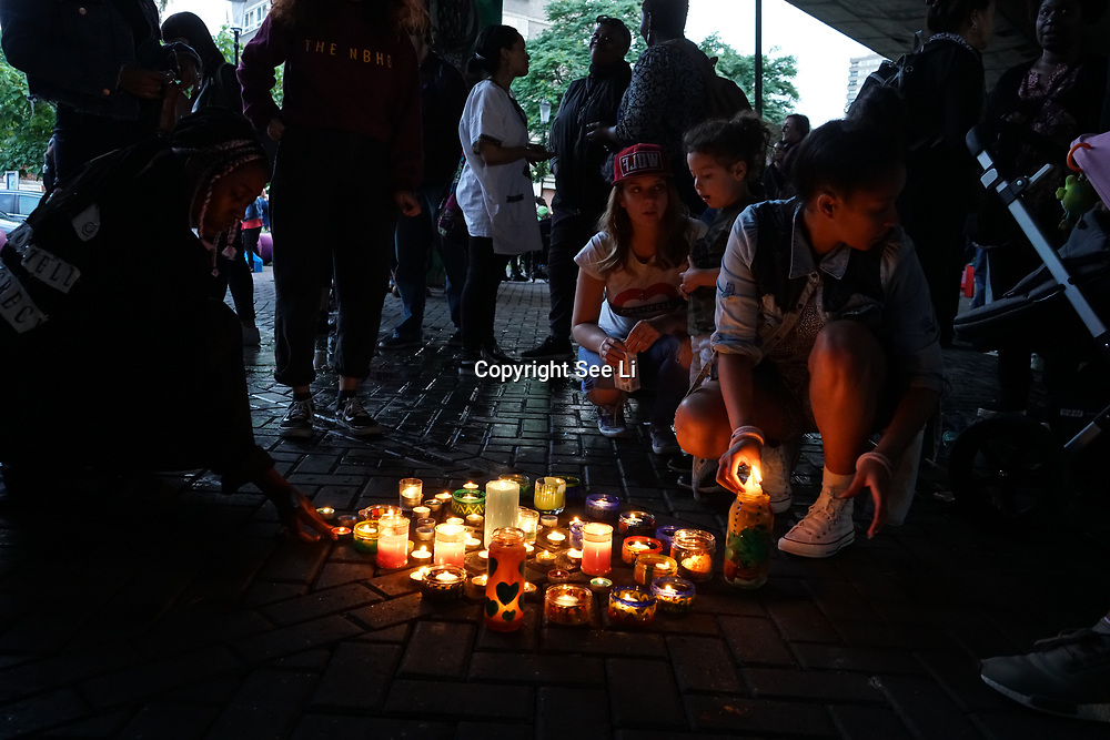London, UK. 14th August, 2017. Local cummunity holde a candles light vigil to pay respect to those who are no longer with us. This is also a movement to ensure we get Justice4Grenfell.