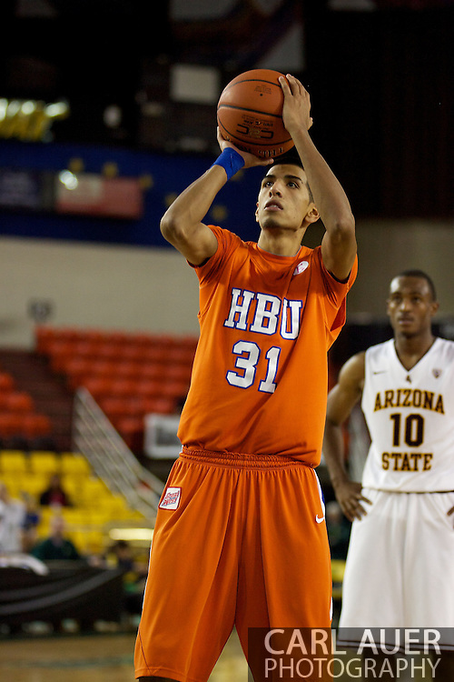 November 25th, 2010:  Anchorage, Alaska - Houston Baptist forward Andrew Gonzalez (31) shoots a free throw in the Huskies 55-73 loss to Arizona State at the Great Alaska Shootout.  Gonzalez led all scorers with 26 points.