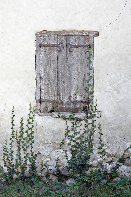 old deteriorating wooden window shutters