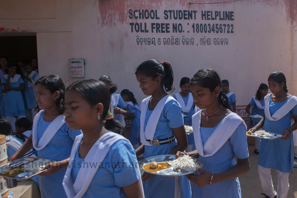 Village: Baluka, Keonjhar, Odisha, India, 3 March 2013:.Children of Kastuba Gandhi Balika Vidyalaya, partake mid day meal provided by the school, at Baluka UG UP school in Keonjhar. .School Students Helpline and SAMIKSHA ( analysis) are monitoring and feedback tools, implemented by Odhisa Government for effective implementation of the Right to Education Act in Odhisa. UNICEF India/2013/Prashanth Vishwanathan