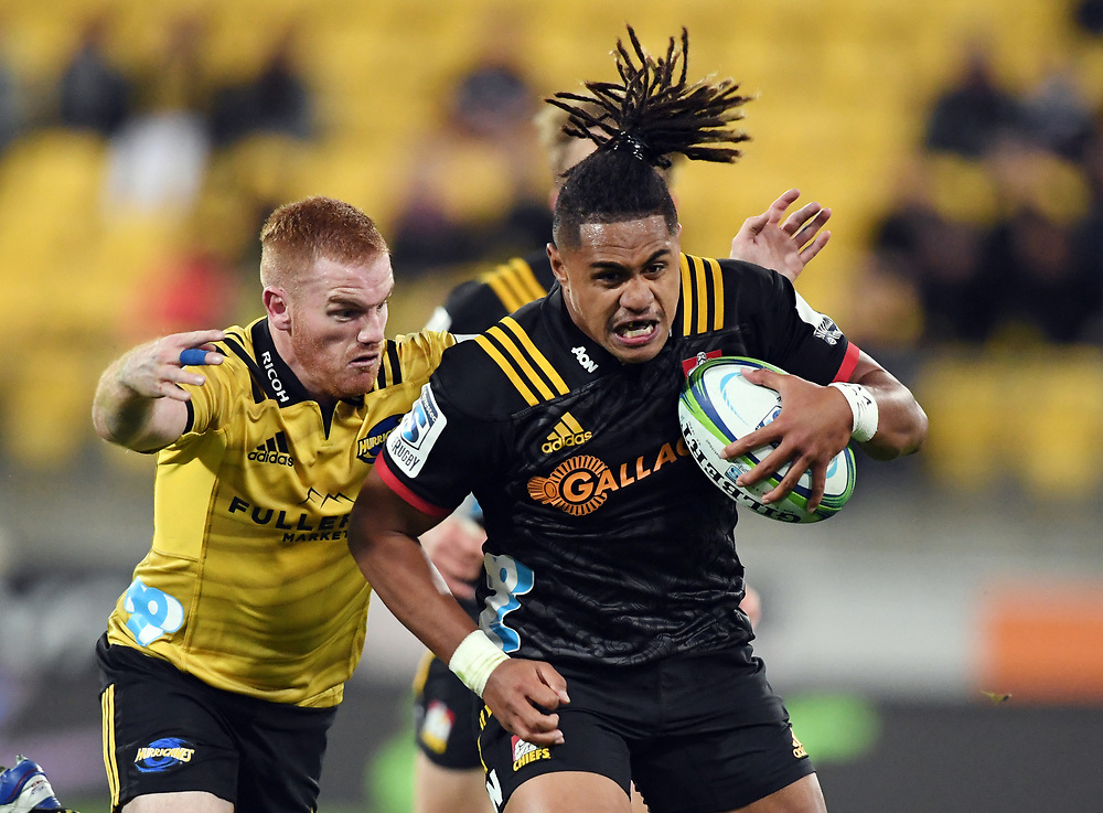 Chiefs Johnny Fa'auli, right, about to be tackled by Hurricanes Jamie Booth in the Super Rugby match at Westpac Stadium, Napier, New Zealand, Friday, April 13, 2018. Credit:SNPA / Ross Setford