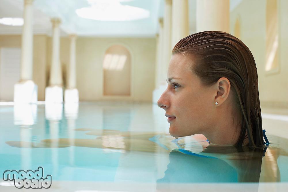 Young woman in swimming pool profile