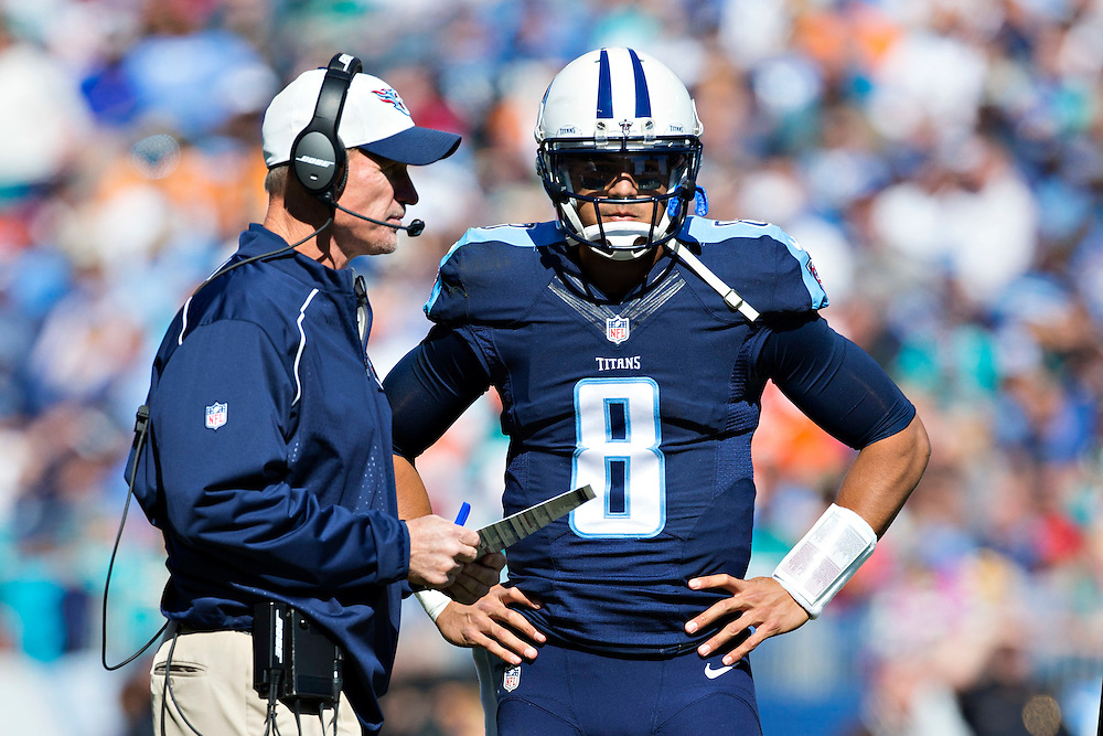 NASHVILLE, TN - OCTOBER 18:  Head Coach Ken Whisenhunt talks with Marcus Mariota #8 of the Tennessee Titans during a timeout against the Miami Dolphins at LP Field on October 18, 2015 in Nashville, Tennessee.  The Dolphins defeated the Titans 38-10.  (Photo by Wesley Hitt/Getty Images) *** Local Caption *** Ken Whisenhunt; Marcus Mariota