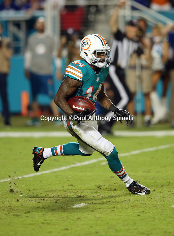 Miami Dolphins wide receiver Jarvis Landry (14) returns a second quarter kick off to the Dolphins 33 yard line during the NFL week 14 regular season football game against the New York Giants on Monday, Dec. 14, 2015 in Miami Gardens, Fla. The Giants won the game 31-24. (©Paul Anthony Spinelli)