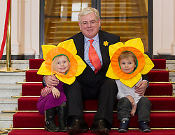 Repro Free: 21/03/2013 An Tánaiste Eamon Gilmore, with Alexandra (4) and Luke O'Donnell (3) from Rathgar, Co.Dublin, puts his stamp of approval on the Irish Cancer Society's Daffodil Day, taking place nationwide tomorrow (Friday 22st March), pictured with a new postage stamp marking the 50th anniversary of the Irish Cancer Society, issued by An Post today.  .The Irish Cancer Society and Dell, lead partners for Daffodil Day, are calling on the Irish public to wear a daffodil today and support those affected by cancer in Ireland. Picture Andres Poveda.