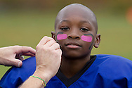 Huguenot, New York - A Middletown player gets his face painted before a game against Port Jervis in an Orange County Youth Football League Division II game on Oct. 4. 2014.
