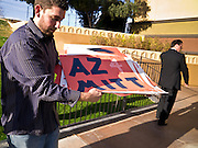13 FEBRUARY 2012 - MESA, AZ:  Romney volunteers carry placards and signs into the amphitheatre in Mesa Monday. Several thousand people crowded into the Mesa Amphitheatre in Mesa, AZ, Monday night to hear Republican Presidential candidate Mitt Romney speak. Romney, a Mormon, is expected to win in Arizona, which has a large Mormon population. Arizona's Republican Presidential primary is February 28.       PHOTO BY JACK KURTZ