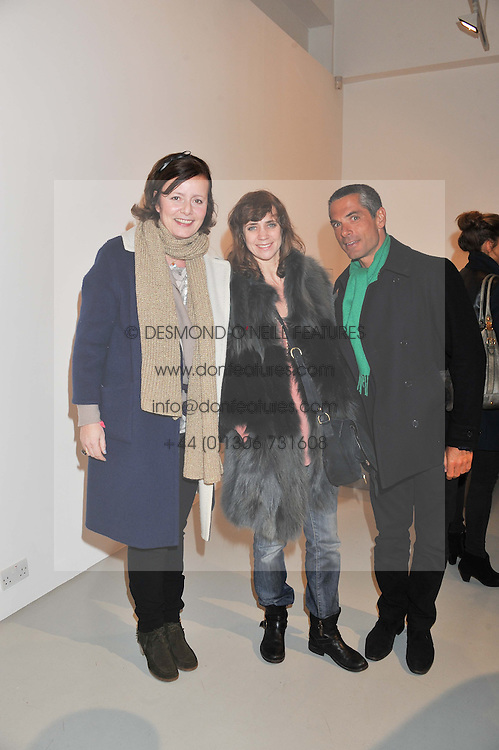 Left to rihght, ISI von STEDINGK, JULIETTE SPILLMANN and SIMONE HAGGIAG at a private view of Tobias Rehberger's latest work entitled 'Sex and Friends' held at the Pilar Corrias Gallery, 54 Eastcastle Street, London W1 on 12th January 2012.
