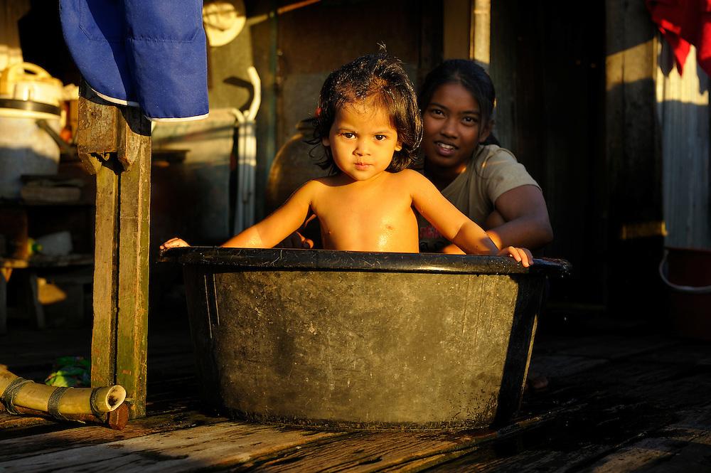 Family living at Chao Phraya River, Bangkok, Thailand