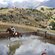 Brad Avery riding Felix in action at the water jump during the Cross Country event at the Wakatipu One Day Horse Trials at the Pony Club grounds,  Queenstown, Otago, New Zealand. 15th January 2012. Photo Tim Clayton3