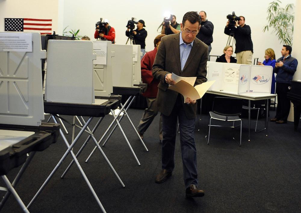Connecticut Gov. Dannel P. Malloy votes, Tuesday, Nov. 4, 2014, in Hartford, Conn.(AP Photo/Jessica Hill)