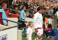LONDON, ENGLAND - Saturday, June 2, 2012: England's captain Steven Gerrard leads his side out to face Belgium during the International Friendly match at Wembley. (Pic by Mark Leech/Pool/Propaganda)