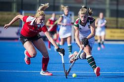 Surbiton's Sarah Haycroft is tackled by Sarah Jones of Holcombe. Holcombe v Surbiton - Investec Women's Hockey League Final, Lee Valley Hockey & Tennis Centre, London, UK on 23 April 2017. Photo: Simon Parker