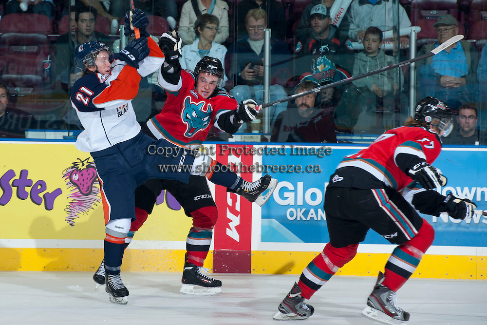 KELOWNA, CANADA - SEPTEMBER 21:  Jesse Lees #2 of the Kelowna Rockets checks Cole Ully #21 of the Kamloops Blazers  at the Kelowna Rockets on September 21, 2013 at Prospera Place in Kelowna, British Columbia, Canada (Photo by Marissa Baecker/Shoot the Breeze) *** Local Caption ***