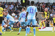 Burton Albion forward Liam Boyce (27) shoots  and his shot is blocked by Coventry City defender Kyle McFadzean (5) during the EFL Sky Bet League 1 match between Burton Albion and Coventry City at the Pirelli Stadium, Burton upon Trent, England on 14 September 2019.