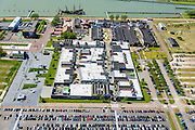 Nederland, Flevoland, Lelystad, 07-05-2015. Oostvaardersdijk, Bataviahaven. shopping center en Fashion Outlet Bataviastad met op de Bataviawerf de replica's van VOC-schip De 7 provinciën (in aanbouw).<br /> Shopping Center and Fashion Outlet Bataviastad and the Batavia Yard with replicas of VOC ship Batavia and the Seven Provinces (under construction).<br /> luchtfoto (toeslag op standard tarieven);<br /> aerial photo (additional fee required);<br /> copyright foto/photo Siebe Swart