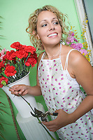 Female florist trimming flowers