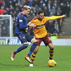 Kyle Lafferty (Hearts) and Charles Dunne (Motherwell) during the Scottish Cup quarter final between Motherwell and Hearts at Fir Park, where the home side made it into the semi final draw with a win.<br /> <br /> (c) Dave Johnston | sportPix.org.uk