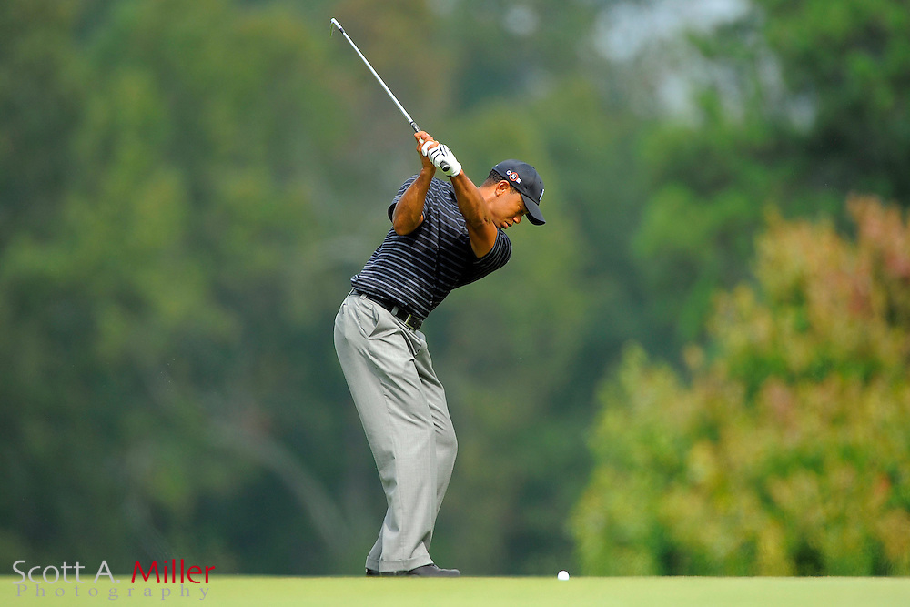 Tiger Woods (USA) makes his second shot on the eighth hole during the third round of the PGA Tour Championship the final event of the 2009 FedEx Cup at East Lake Golf Club on Sept. 26, 2009 in Decatur, Ga.     ..©2009 Scott A. Miller