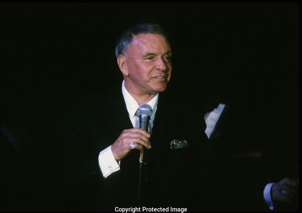 Frank Sinatra sings at a 20th Century Fox dinner during the visit of Queen Elizabeth II to California in March 1983...Photograph by Dennis Brack bb23