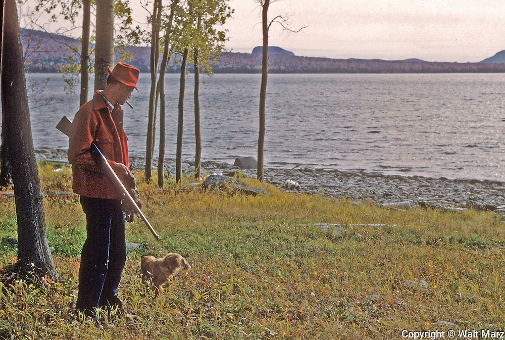 Pete (Burlew) with Rusty, his Cocker Spanial, Moosehead Lake, Maine,  Oct. 1952