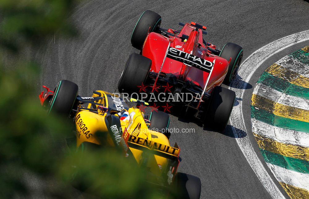 Motorsports / Formula 1: World Championship 2010, GP of Brazil, 07 Felipe Massa (BRA, Scuderia Ferrari Marlboro),  12 Vitaly Petrov (RUS, Renault F1 Team),