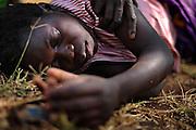 12-03-27   -- KITGUM, UGANDA --  Unconscious nodding disease victim Monica Auma, 16, at the Okidi Central Village Health Centre near Kitgum, Uganda on Tuesday, March 27. When the disease presents itself, Auma hallucinates that she is being surrounded by people who then drag her to water and submerge her.  After running and screaming I don't want to go, Jesus save me, Auma collapses unconscious. Photo by Daniel Hayduk